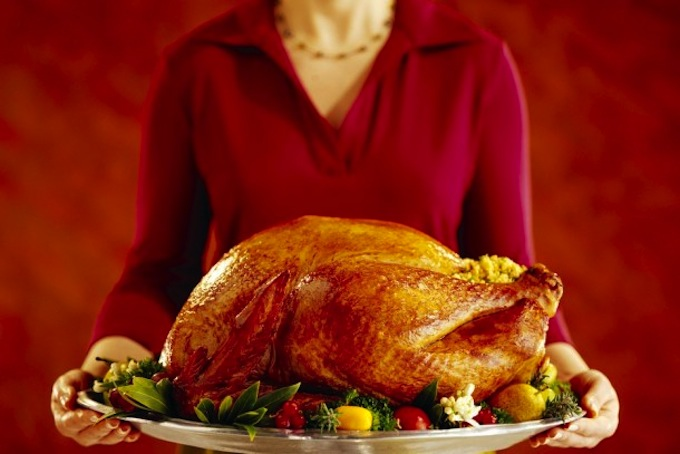 woman holding holiday turkey