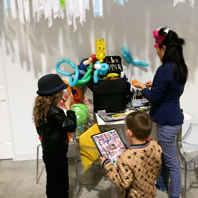 Face painting and balloons kid's activities at Honest Company 2nd birthday