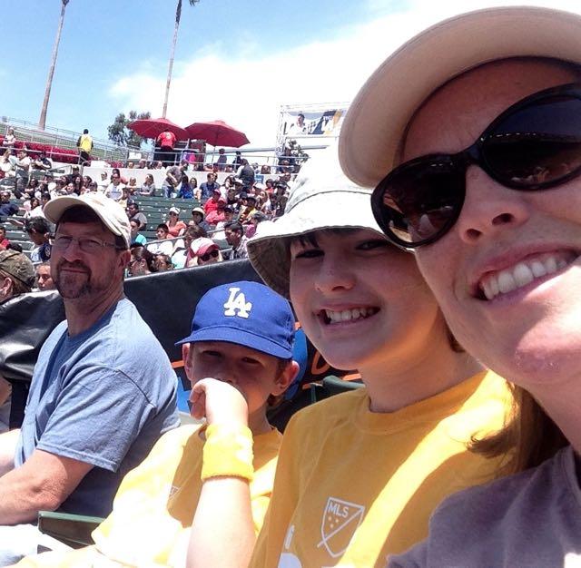 sunscreen family at soccer stadium