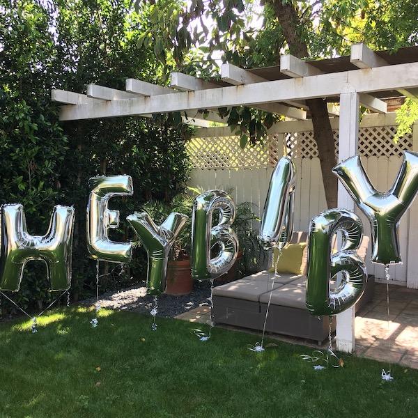 tie dye baby shower letter balloons