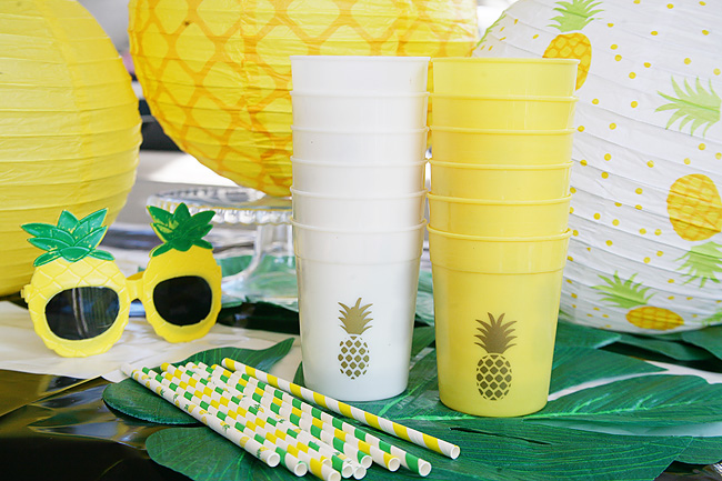 Cute pineapple party supplies and drinkware.